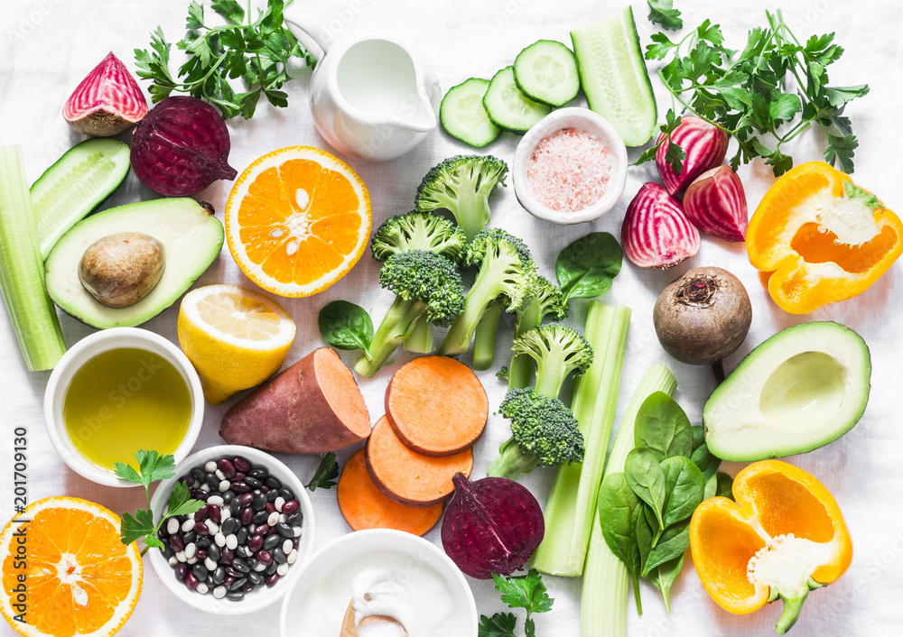 Fototapety, obrazy: Five best vitamins for beautiful skin. Products with vitamins A, B, C, E, K - broccoli, sweet potatoes, orange, avocado, spinach, peppers, olive oil, dairy, beets, cucumber, beens. Flat lay, top view