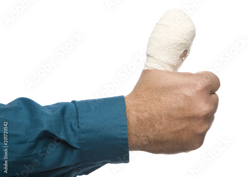 A large bandage on a thumb, disabling the person from work. Fototapet