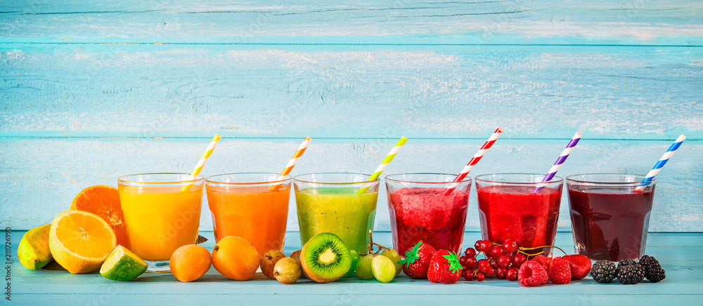 Fototapeta Various freshly squeezed fruits juices