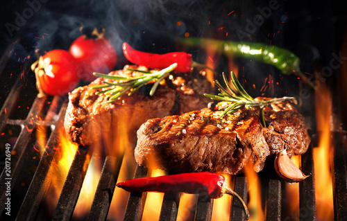 Aluminium Prints Grill / Barbecue Beef steaks on the grill