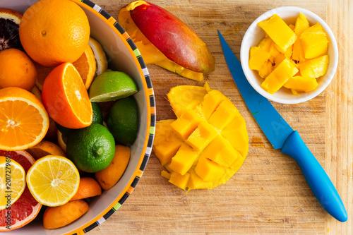 Fotografie, Obraz  Slicing and preparing fresh healthy tropical fruit