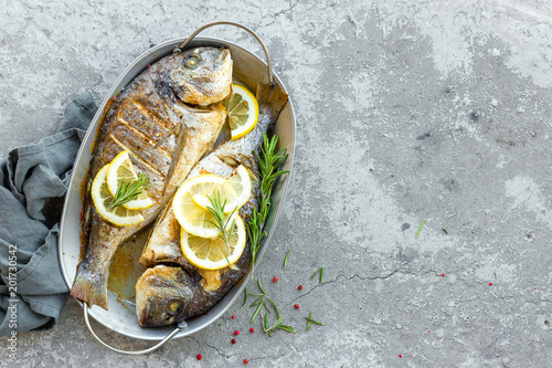 In de dag Vis Baked fish dorado. Sea bream or dorada fish grilled