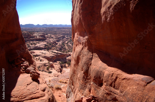 Foto op Plexiglas Bruin View from huge gap in red rock cliffs in the canyon country of the Bears ears area of Southern Utah in the desert badlands of Bisti De Na Zin In Notthern New Mexico