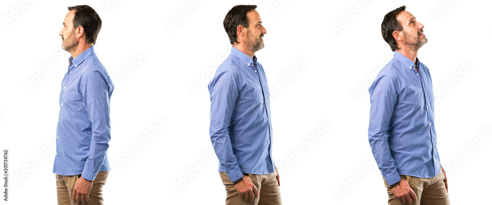 Fototapeta Middle age handsome man side view portrait over white background