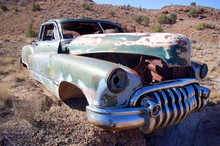 Rusty Oldsmobile Car At An Abo...