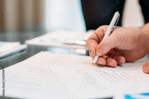 Man Hand Signing Contract Closeup Business Partnership And - Partnership legal documents