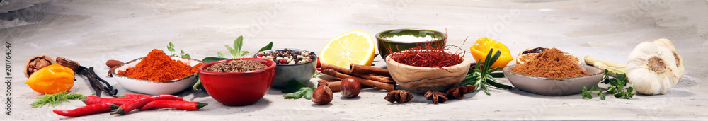 Obraz Spices and herbs on table. Food and cuisine ingredients. fototapeta, plakat