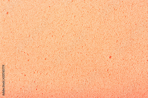 Photo  Peach colored texture of ethylene vinyl acetate