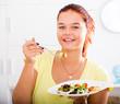 girl enjoying salad