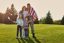 Shot Of Patriotic Family. Sold...