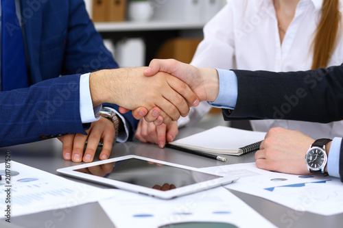 Fototapety, obrazy: Business people shaking hands, finishing up a papers signing. Meeting, agreement and lawyer consulting concept