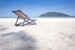 Beach chair on the white beach with beautiful blue sky