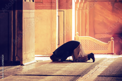 Fotografie, Tablou The muslim prayer for god in the mosque.