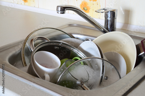 Dirty dishes and unwashed kitchen appliances filled the kitchen sink