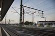 Empty railroad tracks of Mannheim Hauptbahnhof railway station with traffic road in morning