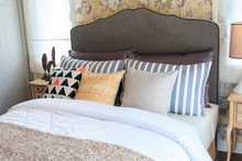 Colorful Pillows On The Bed In...