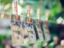 US Dollar Banknotes Hanging On...