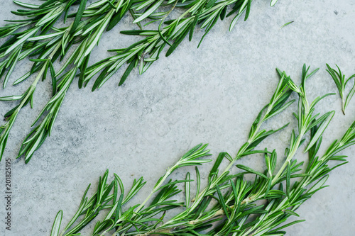 Photo  Flatlay with rosemary sprigs arranged on metallic background with text space at