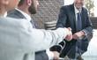 Business people, handshake, finishing the meeting.
