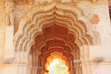 Lotus Mahal Temple In Hampi, Karnataka, India.Beautiful Carved Stone Arch And Sunset. A Popular Tourist Route From The GOA State. Beautiful Hindu Temple