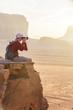 Tourist on rock. Wadi Ram desert. Jordan landscape