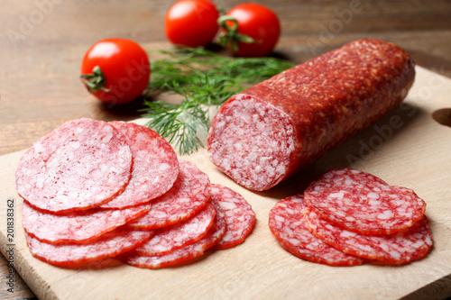 Fototapeta Sausage salami and cherry tomatoes obraz