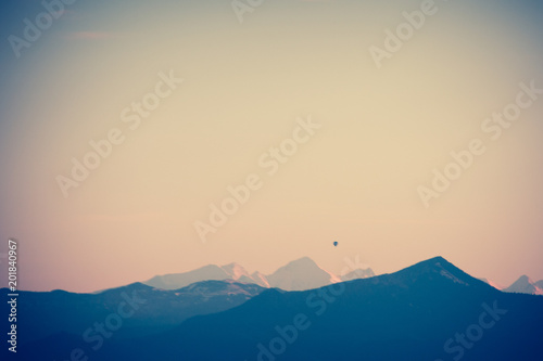 Fototapety, obrazy: Chain of the mountain range of the alps in evening light with a ballon and a vignette filter