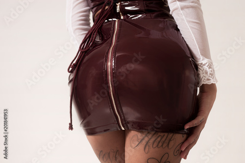 Tattooed woman beautiful bum, wearing latex dress Canvas Print