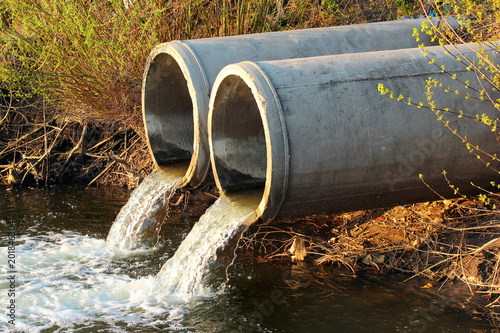 Fototapeta Discharge of sewage into a river