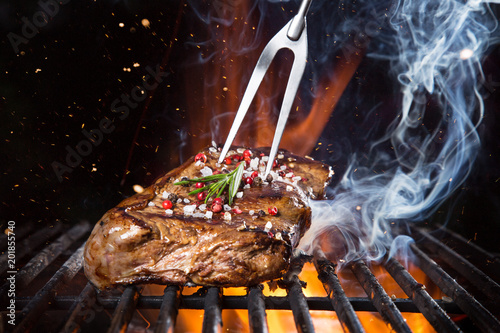 Aluminium Prints Grill / Barbecue Beef steak on the grill with flames