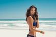 Happy woman walking on beach