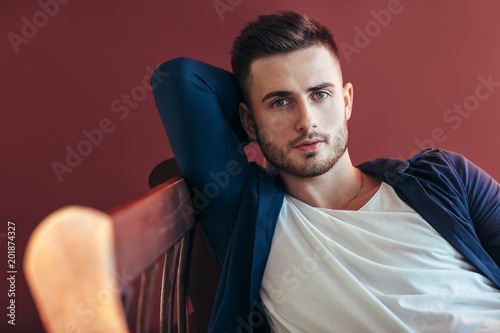 Portrait of handsome sexy man relax on sofa