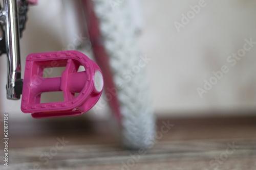 Fototapeta pink child's bicycle closeup obraz