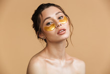 Beautiful Gentle Woman Take Care Of Her Skin With Under Eye Patches.