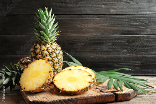 Fresh pineapple on wooden board