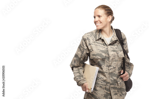 Photo Female airman with books and bag