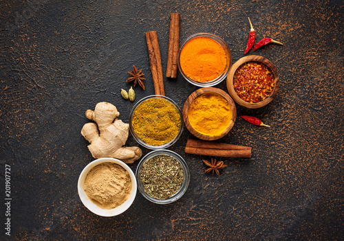 Traditional Indian spices on rusty background Wallpaper Mural