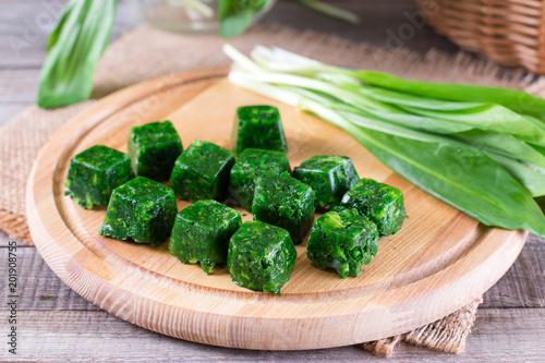 Fotografía  Cubes of frozen spinach