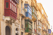 Malta, Valletta, traditional house building facade with sandstones and covered balconies