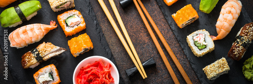 Photo Stands Sushi bar Sushi and sushi roll set on stone table top view