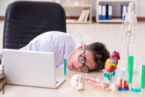 Fototapeta Funny doctor having fun in hospital lab obraz na płótnie