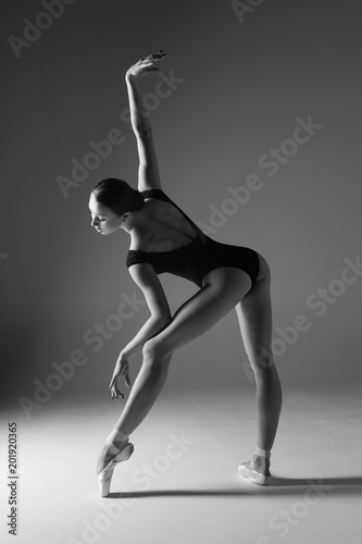 Carta da parati Young beautiful ballerina is posing in studio