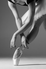 Fototapeta Taniec / Balet Young beautiful ballerina is posing in studio