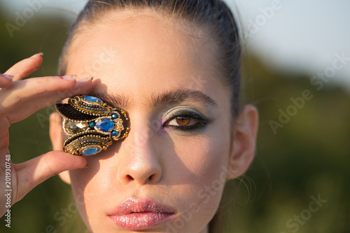 Woman with fly brooch jewelry at makeup face, look Fototapet