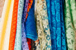 Different types of fabrics are stacked in a row