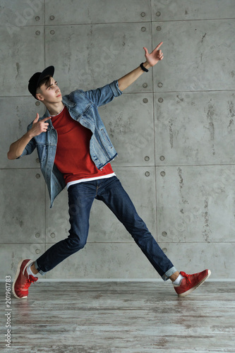 Teenage Boy In Denim Jacket And Baseball Cap Jeans And Red Sweater