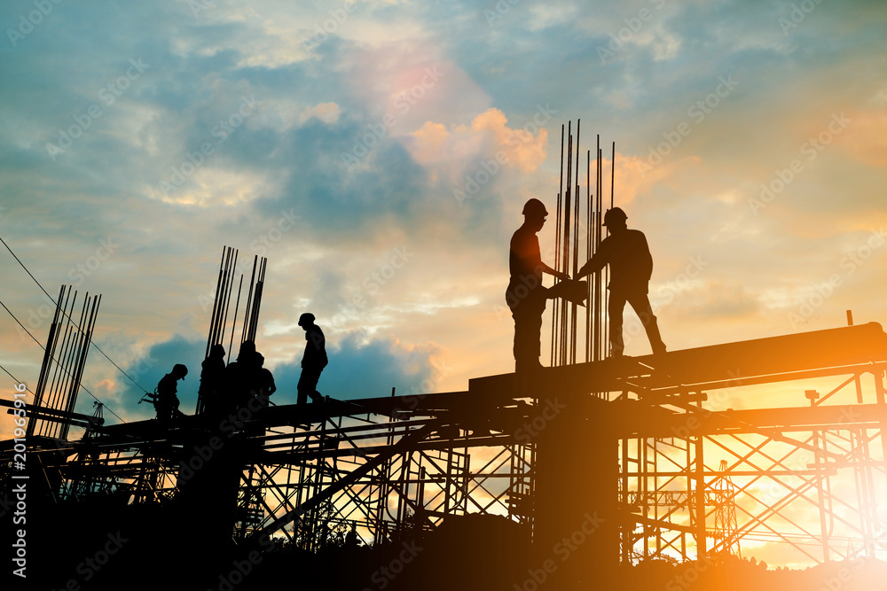 Fototapety, obrazy: Silhouette of engineer and construction team working at site over blurred background sunset pastel for industry background with Light fair.