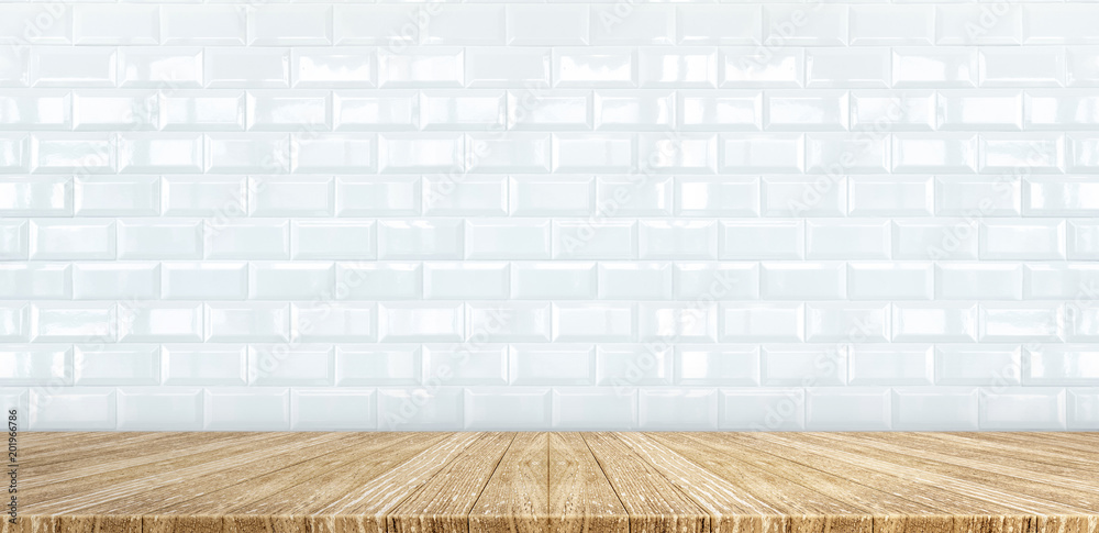 Fototapeta Wood plank table top at white glossy ceramic tile wall background,Mock up for display or montage of product,Banner or header for advertise on social media