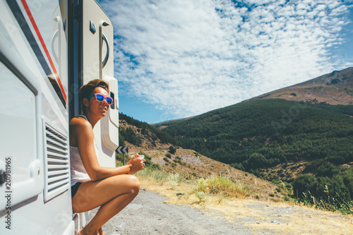 Girl with a cup in a motor home
