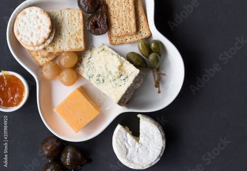 Tuinposter Buffet, Bar Cheese snack plate on black background